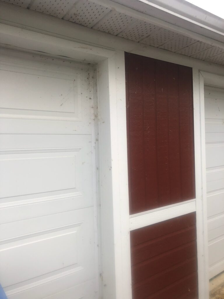 Power washing services cleaned dust off of the garage